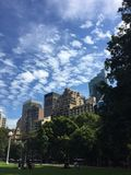 Buildings. Relaxing in the park cloudy blue sky Royalty Free Stock Photo