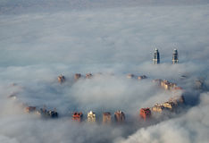 Buildings Rise Above Fog Royalty Free Stock Images