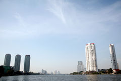 Buildings beside river. Tall building beside the chaophraya river, bangkok, thailand. also good for background Royalty Free Stock Photos