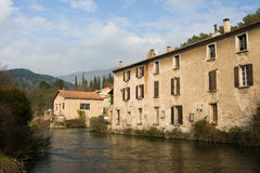 Buildings on a River. Near isle sur la sorgue in Provence, France Royalty Free Stock Images