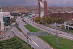 Buildings and roadways in Albany, NY. As seen looking southward from the Empire State Plaza with Fall foliage in background Royalty Free Stock Image
