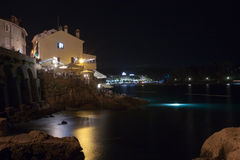 Buildings on rocky coast of old port town Rovinj in the night in Stock Photography