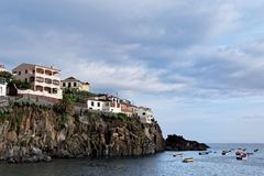 Buildings on the rocky coastline in a port of Camara de Lobos on Madeira. Buildings on the rocky coastline in a port of Camara de Lobos on Portuguese island of royalty free stock image