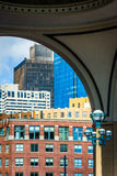 Buildings seen through the arch at Rowes Wharf in Boston, Massac Royalty Free Stock Photography