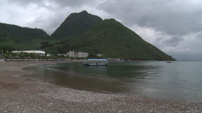 Buildings on shore of lake in mountains in province. stock video