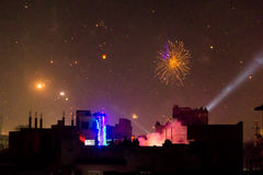 Buildings silhouetted against fireworks in Jaipur Stock Images