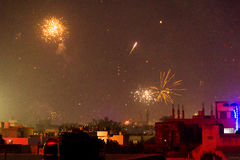 Buildings silhouetted against fireworks in Jaipur Stock Photo