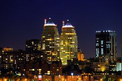 Buildings, skyscrapers and towers of the Dnepr city are reflected in the Dnieper River at night. Dnipro city. Buildings, skyscrapers and towers of the Dnepr city stock photo