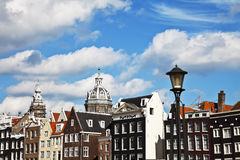 Buildings and St Nicholas Church in Amsterdam Royalty Free Stock Image