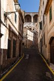 Buildings and street in brown tones. Empty narrow dark street in an ancient, historic city; buildings and street in brown tones royalty free stock photos