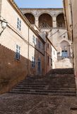 Buildings and street in brown tones. Empty narrow dark street in an ancient, historic city; buildings and street in brown tones stock photos