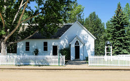 Church in historic Fort Edmonton, Alberta, Canada. Picket fence in front of historic wooden church in frontier town of Fort Edmonton, Alberta, Canada stock photos