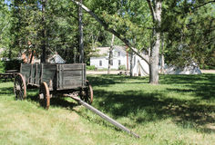 Wagon in field, Fort Edmonton, Alberta, Canada. Wooden wagon in field outside historic homes in Fort Edmonton, Alberta, Canada stock image
