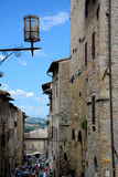 Buildings and street in San Gimignano city in Tuscany, Italy Royalty Free Stock Photo