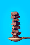 Buildings from sugar cubes and chocololate on a blue background Royalty Free Stock Photo