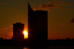 Buildings at sunset. Silhouette of two buildings by the river at sunset Stock Photography