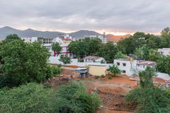 Buildings on the sunset background, Puttaparthi, Andhra Pradesh, India. Copy space for text. Buildings on the sunset background, Puttaparthi, Andhra Pradesh Royalty Free Stock Photos