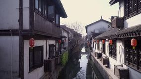 Buildings surrounding the water canals near Nanxiang Old Street in Shanghai China stock video footage