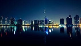 Buildings with their lights reflected in the water