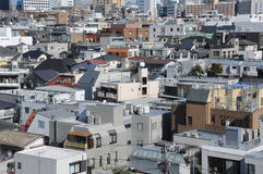 Buildings in Tokyo Japan. Densely populated apartment buildings around Harajuku near Shibuya in Tokyo Japan on clear spring day Stock Image