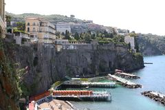 Marina San Francesco Sorrento Italy. Buildings at the top of cliffs leading to the beach and sea at Marina San Francesco Sorrento Italy Stock Photos
