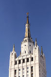 Buildings top with spire. Huge house built in the soviet style with columns, balconies, turrets and statues royalty free stock images