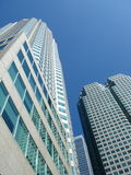 Buildings in Totonto, Canada. Buildings in Toronto city, Canada,  photographed from below with deep blue sky Royalty Free Stock Photo
