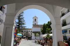 Buildings and tourists in Nerja, Andalusia, Spain Stock Images
