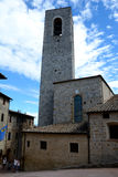 Buildings and tower in San Gimignano city in Tuscany, Italy. Stock Photos