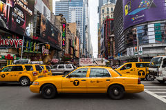 Buildings and Traffic in New York City. NEW YORK CITY, USA - 31ST AUGUST 2014: Buildings and traffic in New York City in the Theatre District during the day Stock Images