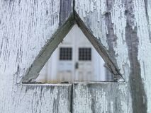 Buildings: Triangle wood cut out in front of church doors. Stock Photography