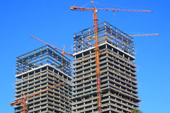 Buildings under construct. Tow Buildings under construct in the blue sky Stock Photography