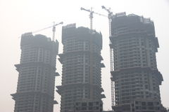 Buildings Under Construction in China. Three buildings under construction in Chongqing, China Stock Photography