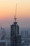Buildings under construction with cranes Stock Images