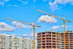 Buildings under construction with cranes Stock Photography