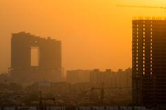 Buildings under construction at dusk Royalty Free Stock Photography