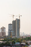Buildings under construction. High-rise buildings under construction with tower crane Stock Image