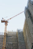 Buildings under construction. Tower crane with high-rise buildings under construction Stock Photography
