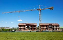 Buildings under construstion with crane Stock Photography