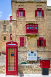 Buildings in Valletta and Red Phone Booth - Valletta, Malta Stock Images