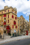Buildings in Valletta and Red Phone Booth - Valletta, Malta Stock Image
