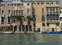 Buildings on Venice waterway in Italy. Stock Images