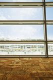 Buildings viewed through window of airport, Shimla, Himac Royalty Free Stock Images