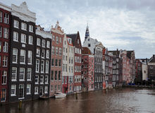 Buildings on the water in Amsterdam Stock Photos