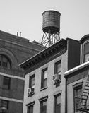 A buildings and water tank in black and white, USA royalty free stock photography