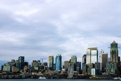 Buildings and waterfront attractions Elliott Bay Seattle downtown skyline stock photos