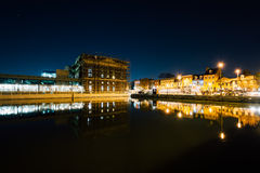 Buildings on the waterfront in Fells Point at night, in Baltimor. E, Maryland stock photo