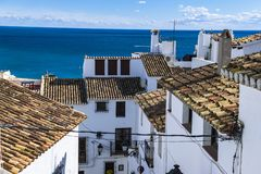 Buildings with white facades with their backs to the sea in a beautiful summer in the Mediterranean. Photograph taken in Altea, Alicante, Spain royalty free stock photos