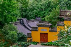 Buildings with yellow wall, red door, and black roof tiles, Lingyin Temple, Hangzhou, China stock image