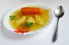 Buillon with dumplings and carrots Stock Image